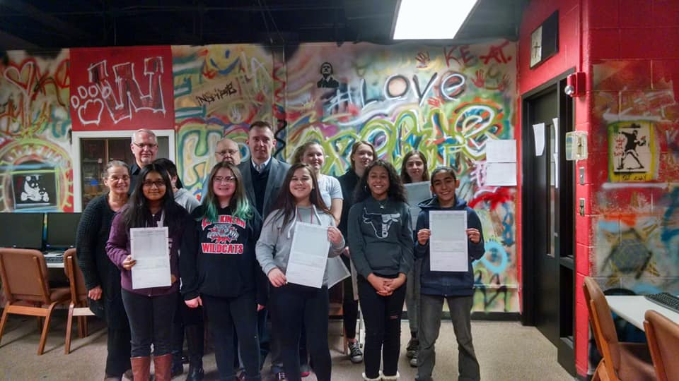 Presenting DDA Art Challenge Awards at Wilkinson Middle School